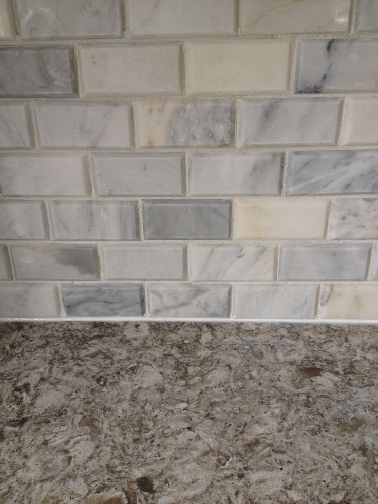 Carrera Marble Beveled Subway Tile Backsplash And Quartz