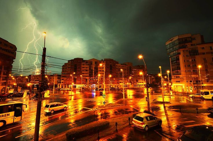 """""""The storm starts when the drops start dropping When the drops stop dropping then the storm starts stopping."""" ―Dr. Seuss  Baia Mare, today, 5 am Photo: Diana Topan #storm #thunder #lighting #rain #5am #baiamare #Romania #gloomy #mood #colors #citylights #city #cityscape #clouds #weather #stormyweather"""