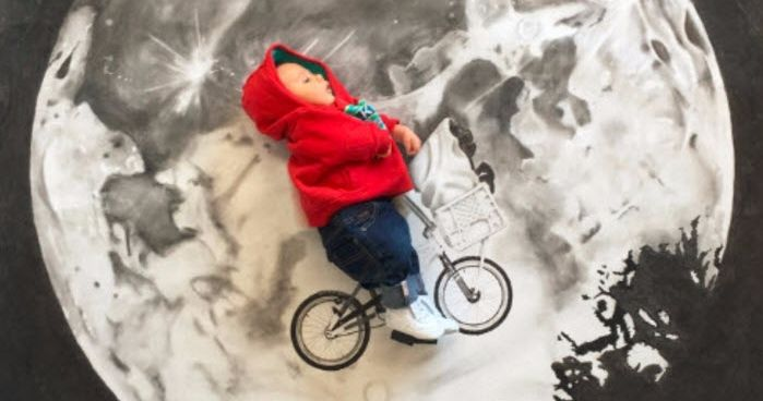 Mum turns baby into a film star! See the incredible drawings. She came up with the idea when she was pregnant, and would first create a small version of the scene with a space left for her unborn baby, and then scale it up, using charcoal on paper.