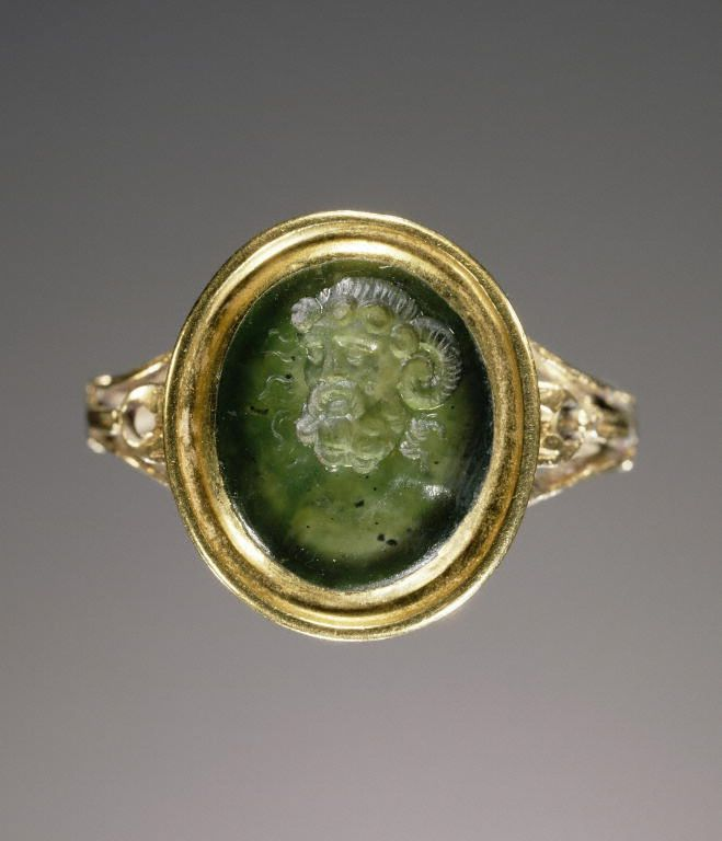 Engraved nephrite set into a gold ring, gem 1st century, ring modern.
