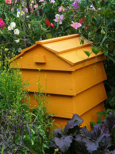"""I have been looking for beautiful ways for the past year on how to """"blend""""my composting bin into the garden setting without it looking like an ugly eyesore. I think the UK is much more ahead of us, with their thinking and I have discovered these gorgeous composting bins designed to look like beehives. I …"""