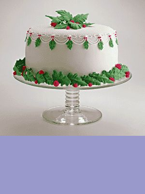 I can't do up a cake like my SIL but last year I bought a Pepperidge farm white layer cake. Added small green leaf shaped sugar cookies around it & a few on top then added a few cinnamon red hot candies. Kind of the same look (I think it's easier to cut square cakes too) All cost about under 6 bucks too