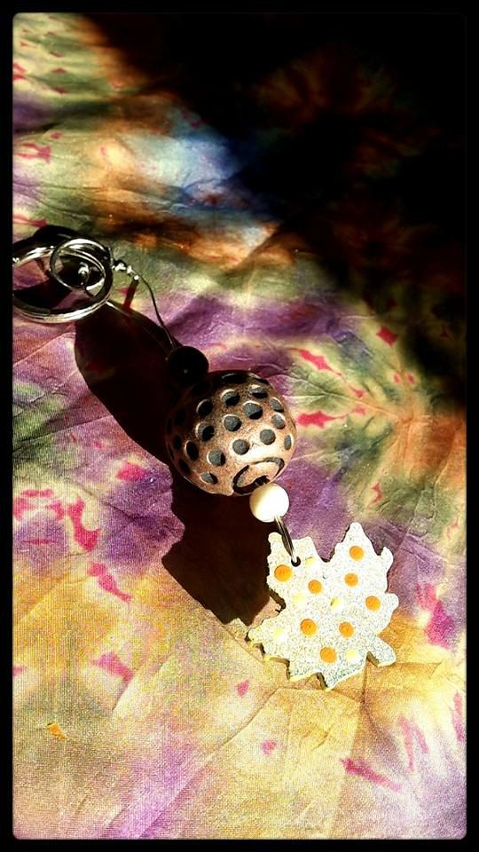 Wood, hand painted maple leaf on copper wire with a selection of beads. ooak