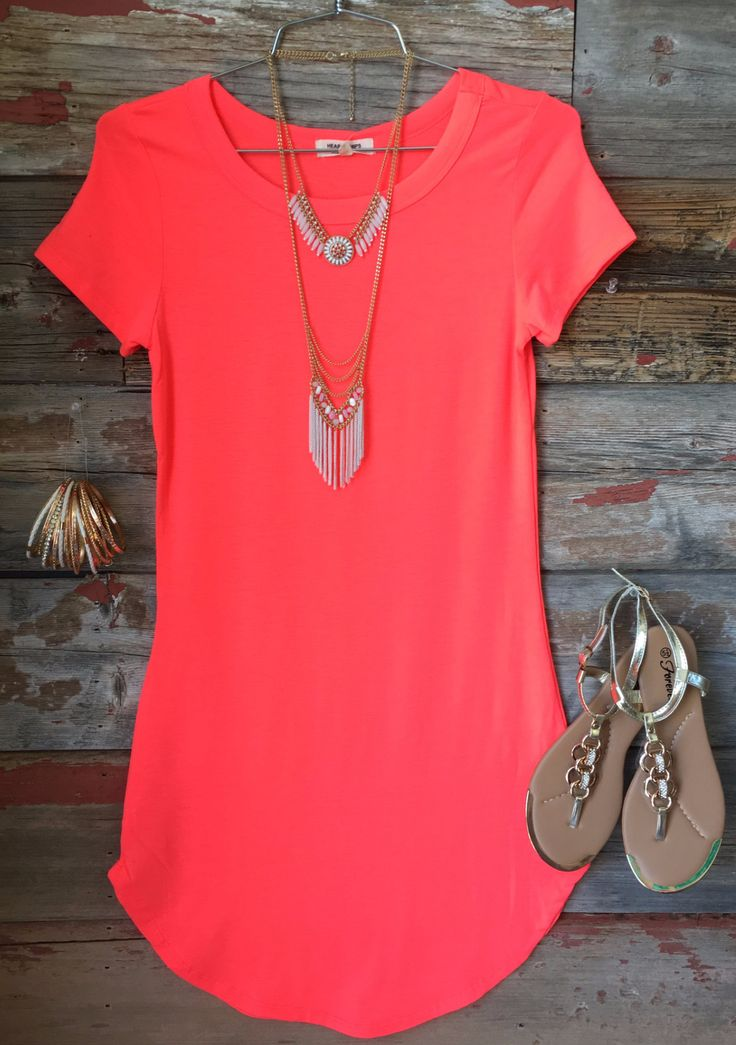 The Fun in the Sun Tunic Dress in Neon Coral is comfy, fitted, and oh so fabulous! A great basic that can be dressed up or down! (www.privityboutique.com) #neoncoral #tshirt #dress #fitted #stretchy #adorable