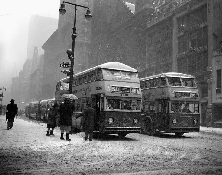 Fifth Avenue is void of its usual crowds of people as shoppers hurry home to get out of a wind-driven snowstorm in 1948.