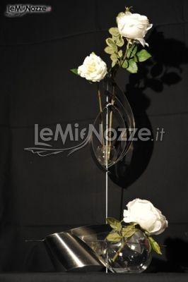 http://www.lemienozze.it/gallerie/foto-fiori-e-allestimenti-matrimonio/img22326.html  Composizione di fiori per il matrimonio per l'allestimento degli interni