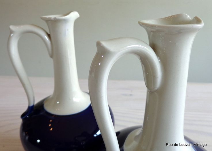 A pair of antique stoneware jugs, two-tone stoneware oil containers, vintage long necked oil jugs by RueDeLouvain on Etsy