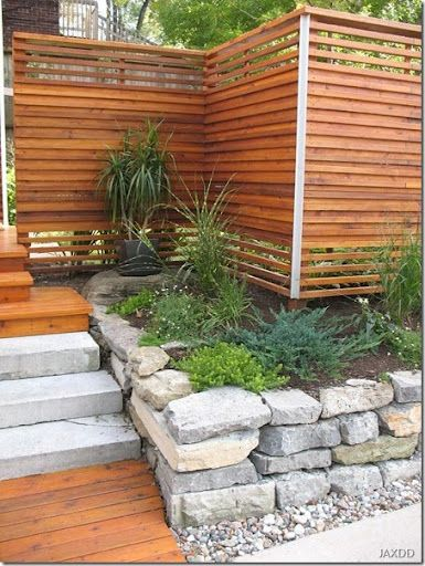 Clean-lined wood slat fence: privacy screen or to hide ugly outdoor stuff like garbage cans or heat pumps.