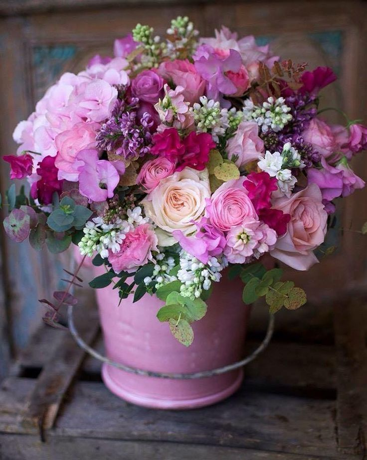 Floral Arrangement with pink and purple flowers in pink pail or bucket