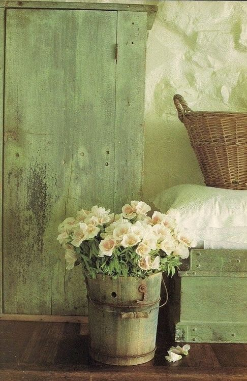 french country-a weathered shutter, a wooden bucket and a basket create a French country vignette.