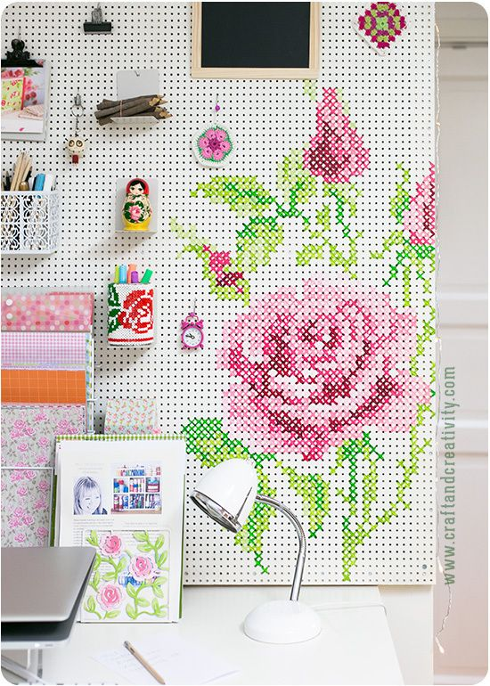 Paint a cross stitch pattern on your pegboard-- fantastic alternative to just solid colors.