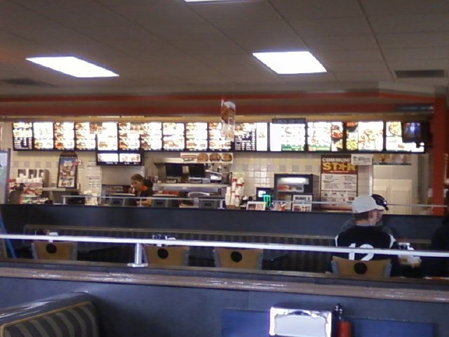 A photo of the inside of Carls' Jr.,with the menu along the back wall. Wonderful service too,for us every time