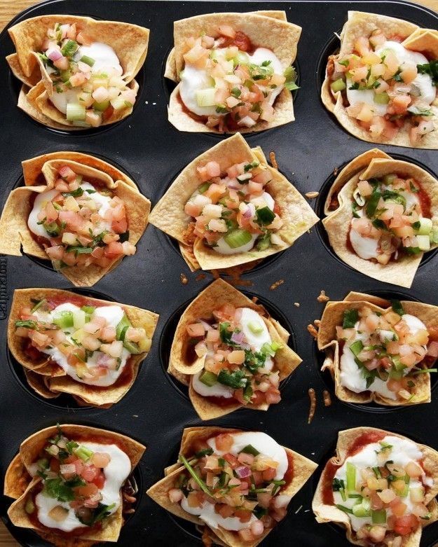 7 Layer Cups ~ Ditch the Guac and add taco meat and caramelized onions and red bell peppers to the bean and cheese layer...