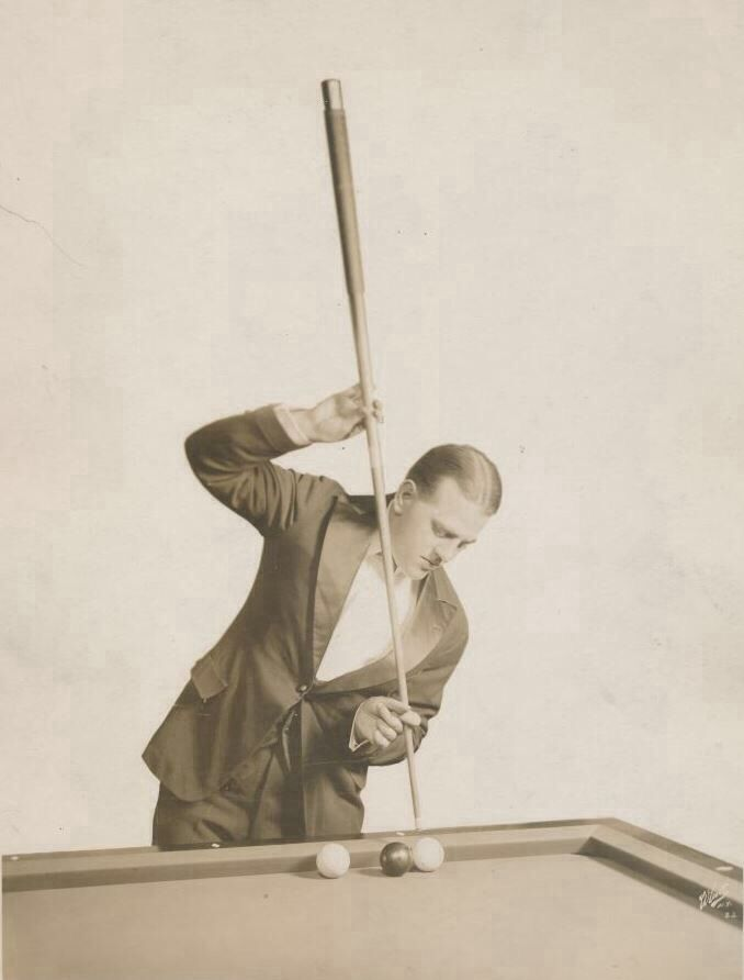 POOL: Willie Hoppe performing a trick shot  in 1919. Hoppe became a champion pool player at the age of 16. He was the best at his sport throughout the era. [See video]