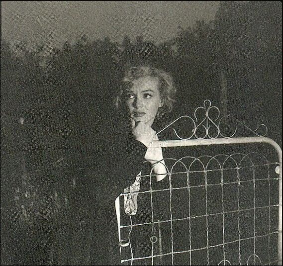 "Monroe called Andre de Dienes late one night unable to sleep and in the grip of a dark depression.He picked her up and they took these shots in the dingy back alleys of the Hollywood hills. The cars headlights light the shots. Monroe told de Dienes to title the shots ""The End Of Everything"""