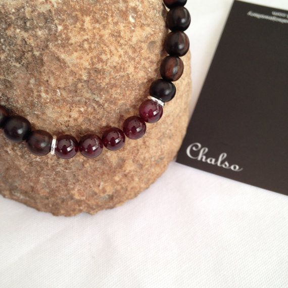 Tiger Ebony and Garnet stretch bracelet by Chalso on Etsy Beautiful rich dark brown and reds. Beads are 6mm, smooth and round. there are two thin, silver plated, spacer beads positioned between the wood and the 5 garnet beads.  18cm stretch bracelet.