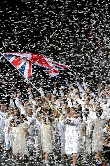 The Team GB athletes were showered in white tickertape and cheered to the rafters by the home crowd (Marine Chris Sherrington behind Great Britain sign)