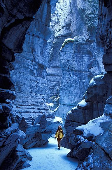 Picture of a woman walking on ice in Maligne Canyon, Jasper National Park