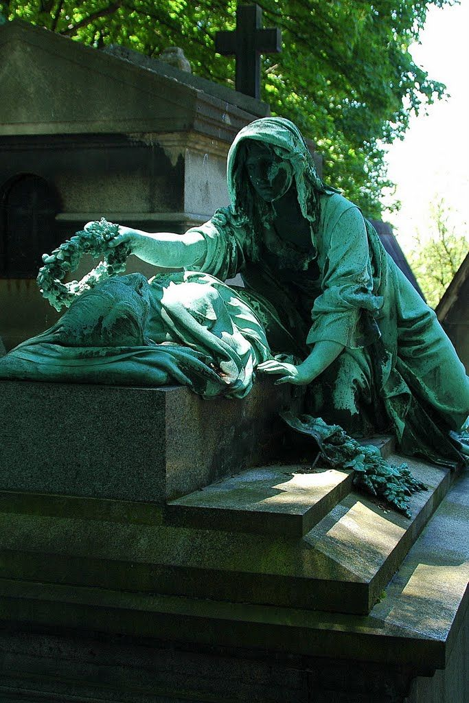 Statue at Pere Lachaise Cemetery, Paris - a wreath of flowers for your head, a pillow of stone for your bed. a smile. a tear. i'll tarry here. i'll speak to you even though you're dead.