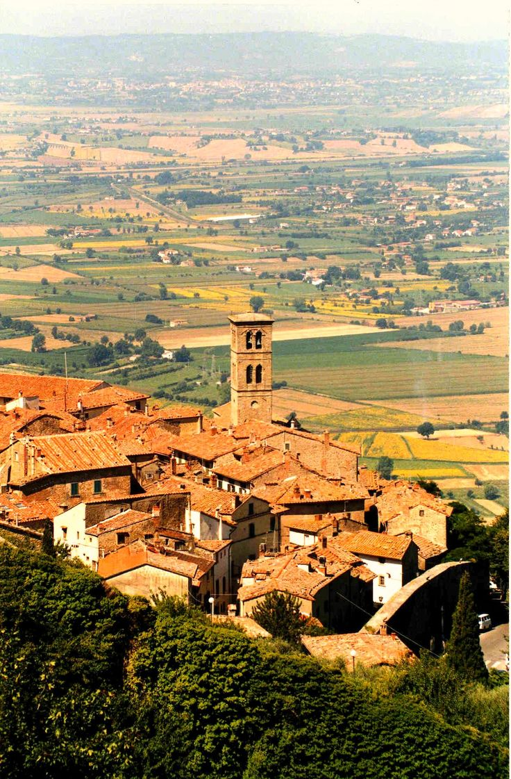 "Cortona, Tuscany, Italy - this town was the set for the movie ""Under the Tuscan Sun "". It has a fantastic view of the surrounding Tuscan hills due to it's high altitude ... I couldn't believe how beautiful it was colourful gardens, winding alleys, great food, cafes, galleries and boutiques ..."