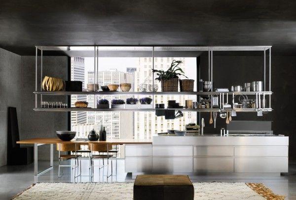 Very organized, functional kitchen using overhead stainless steel racks.