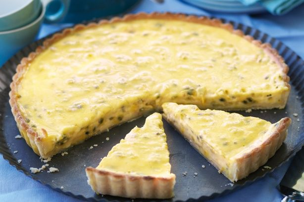 Why wait until summer? Bring tropical fruit flavour to your afternoon with this baked passionfruit tart.