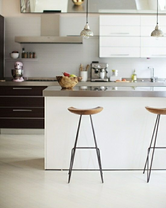 Emeco bar stools from Living Edge tuck neatly under a calacatta