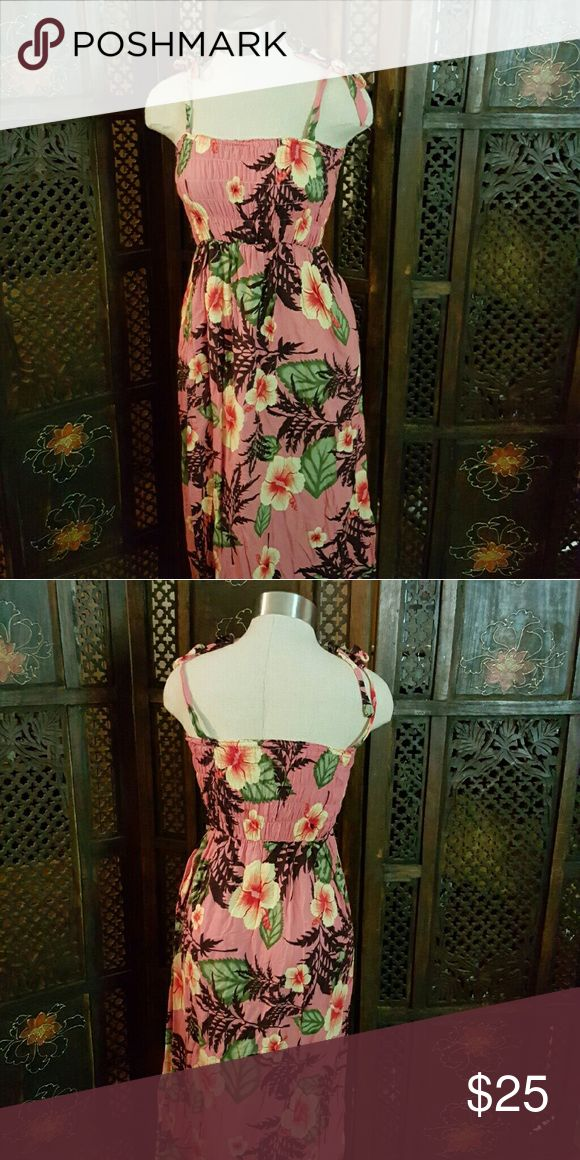 Hawaiin Dress 38in from top to bottom.  Super cute for summer or a hawaiin themed party and if you are lucky enough, you can wear this on a trip to Hawaii!!!  Has one side pocket and ties at the shoulder. Dresses