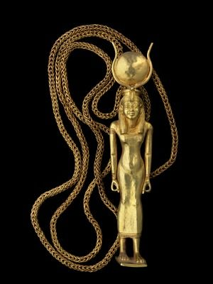 An ancient Egyptian gold pendant that once belonged to General Undjebauendjed; depicted is the goddess Isis, with her symbolic headdress of a pair of cow's horns enclosing a solar disc.