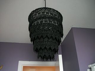 Metal rings from lampshades and metal rings made from coat hangers, covered with lace and turned into chandeleir