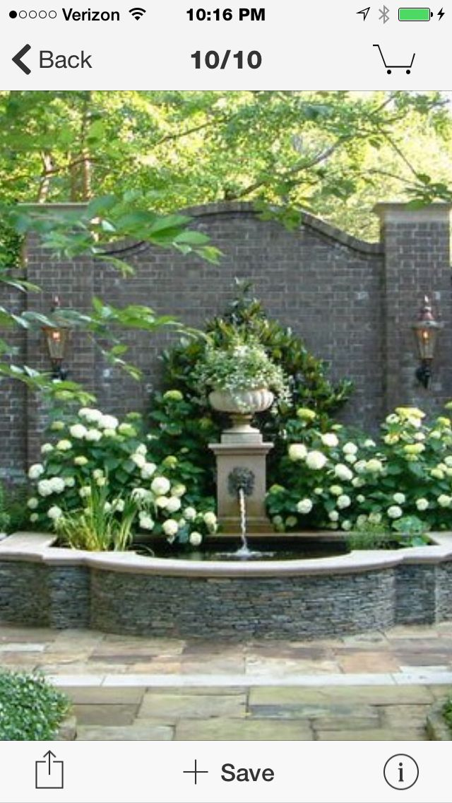 Lions Head fountain on Garden wall. Beautiful!