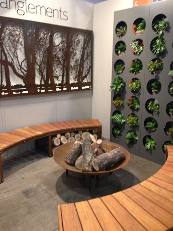 Curved benches and a vertical wall garden by Entanglements metal art.  The Murray corten wall art features on the wall with internal lighting