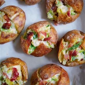 Bubble and squeak jacket potatoes recipe. A baked potato with a difference. Turn a plain potato into a tasty treat using leftover sprouts and bacon.