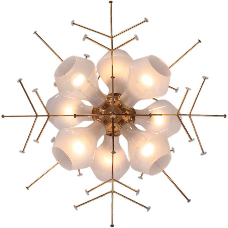 the Snowflake Fixture by Paavo Tynell  Finland  1950's  A brass snowflake ceiling fixture with eight translucent white glass shades. designed by Paavo Tynell made by TAITO OY