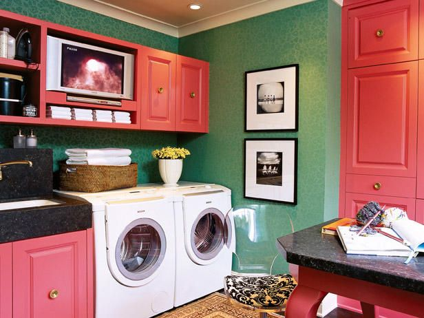 This colorful room with generous storage, easy-to-clean marble and a built-in TV/DVD player makes laundry time less of a chore.