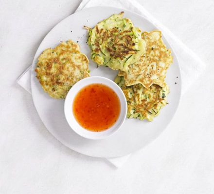 Grate your courgette and add to a pancake batter then fry up these mini veggie patties with chilli dip