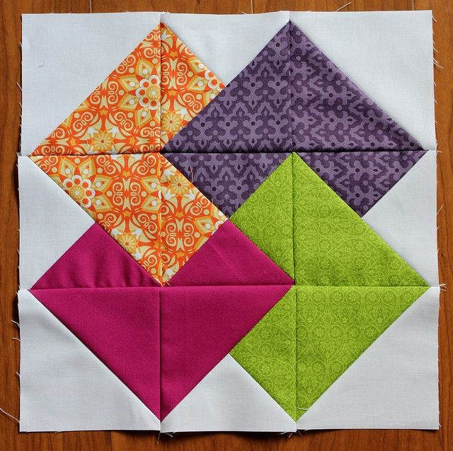 """Card Trick Block {Tutorial} @ Buttons & Butterflies: I recommend high contrast or value fabrics for this block. Each """"card"""" will stand out more effectively while overlapping. Too low of contrast will cause them to blend more. For the sake of the bee quilt, I am requesting white backgrounds, but I think this would be an amazing quilt with a low volume background print..."""