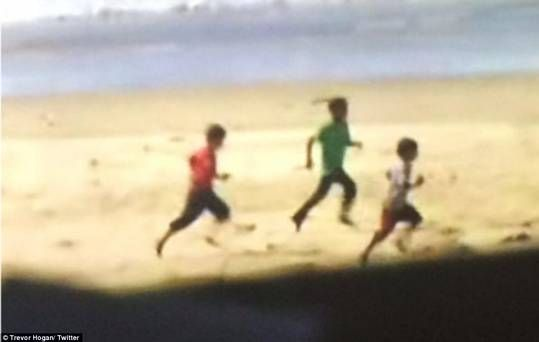This image posted on Twitter shows three of the boys running along the beach moments before they were killed. Photograph Trevor Hogan/Twitter