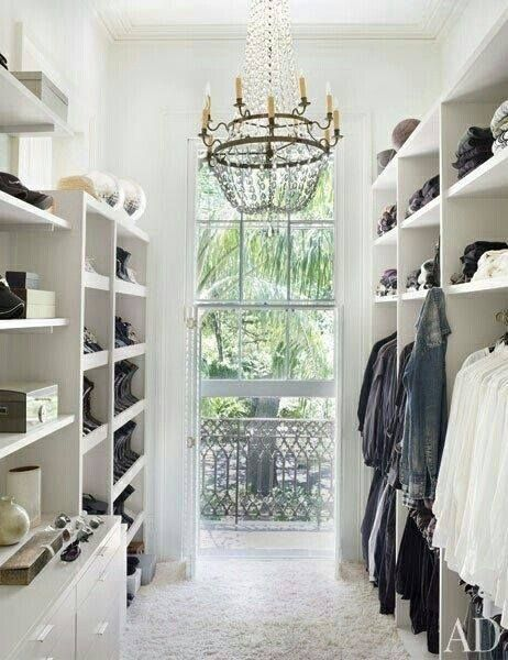Walk-in closet.  Love the idea of the window to give natural light.  Makes it easier to see everything.