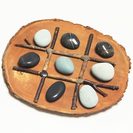 Tic-Tac-Toe Board from twigs and rocks.  Great idea for a kid gift from a kid!