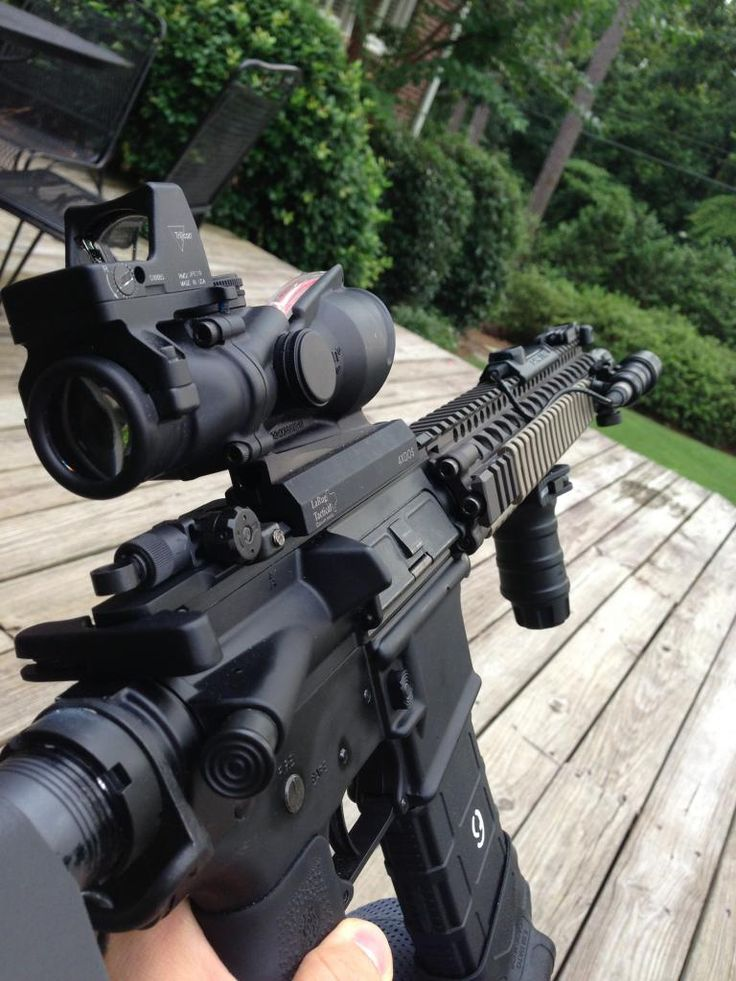 AR with Trijicon ACOG and RMR combo on a LaRue mount, SCAR style flip rear sight, and Daniel Defense rail.