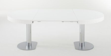 The Craft 2 by Delo Lindo in 2010, re design to incoporate the extension leaves. This approach leave the fringe unfulfilled when the table in extended. Available in all the same finishes and with a square top version. 74h x 130x217 cm.