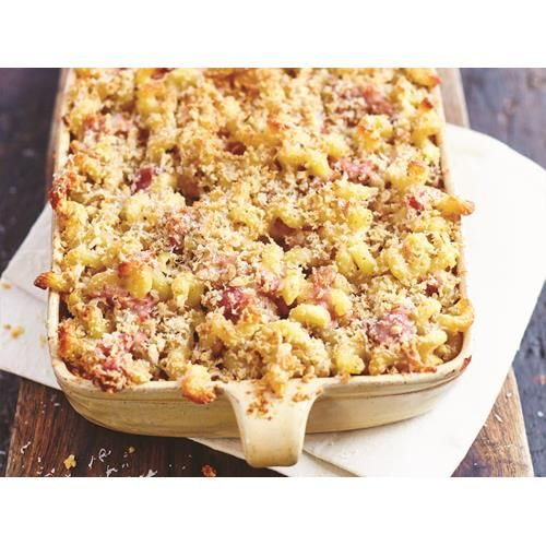 Baked four-cheese spirali recipe - By FOOD TO LOVE, This hearty bake by Gennaro Contaldo's book, The Pasta Book, combines four types of oozy melted cheese with fresh ham, crunchy walnuts and perfectly cooked spirali.