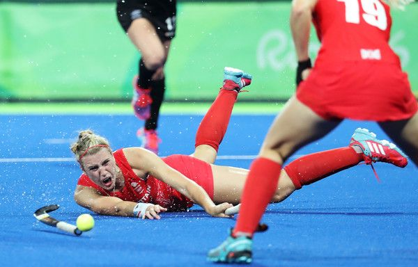 Lily Owsley Photos Photos - Lily Owsley #26 of Great Britain falls during the Women's Semifinal match between New Zealand and Great Britain on Day 12 of the Rio 2016 Olympic Games at the Olympic Hockey Centre on August 17, 2016 in Rio de Janeiro, Brazil. - Hockey - Olympics: Day 12