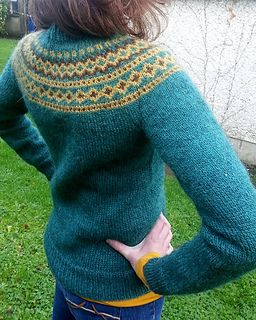 This sweater is knit in the traditional Icelandic Lopapeysa style. The body and sleeves are worked in the round from the bottom up and are then joined together to form a yoke i.e. the circular patterned area around the shoulders. The body is waisted and short rows are used at the neck to provide a comfortable fit.
