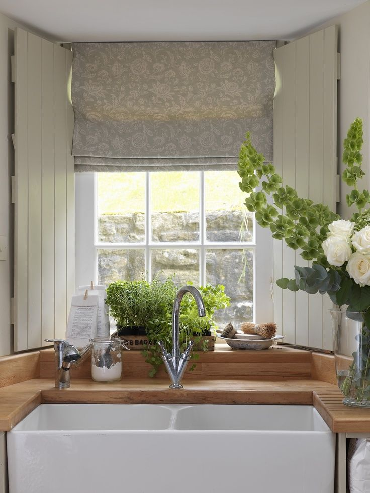 This heavenly kitchen blind in softest aqua is Cabbages and Roses French Toile...full details and lots more images on Modern Country Style blog: Faded Florals In Soft Neutrals: Get The Look