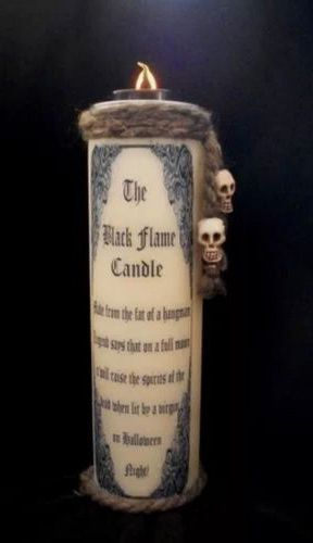 Home made Hocus Pocus Black Flame Candle.  The top is a battery operated tea light.  There is twine and the black flame candle spell.  You can do this.
