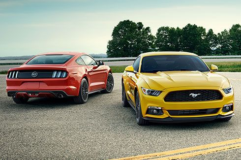 Mustang GT Fastback in Race Red and Mustang EcoBoost Fastback in Triple Yellow.