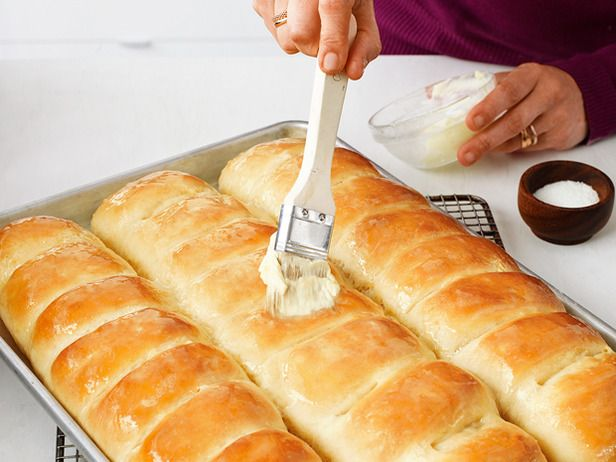 Alex Guarnaschelli's Parker House rolls...with photo instructions! Diane's note: these are now a thanksgiving/family gathering tradition! Everyone asks me to make them! They are superb! My copy of food network mag that had these in it, is worn out and over 3 yrs old! Glad I found a pin!