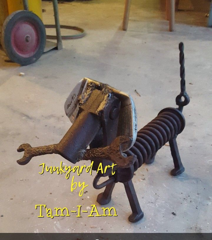 Scrap metal art - dog made from old spring, railroad spikes, wrench, golf club heads, and drill bit